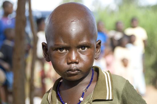 Millennium Villege - Mayange, Rwanda.  Boy staring into camera.