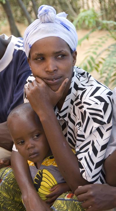 Millennium Village - Mayange, Rwanda.  Survivor and son.