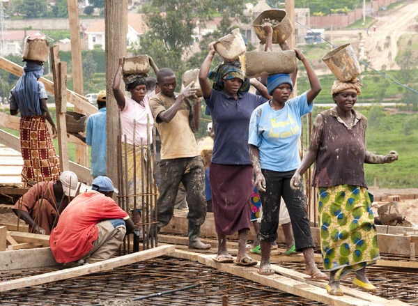 Once up, workers walk on a planks to avoid damaging the reinforcing metal lattice set into the floor.