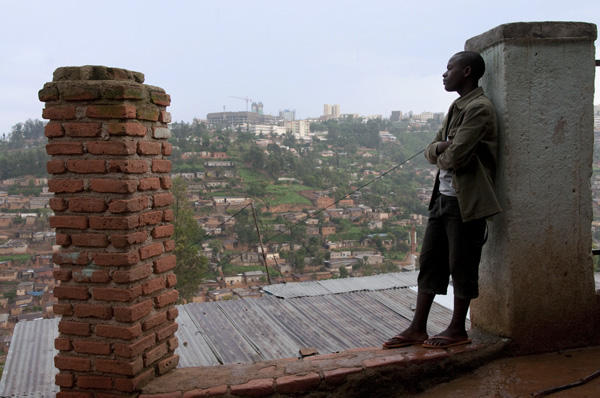 At the top of the hill, Kigali city center is prominent.