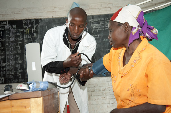 Checking blood pressure of local resident.