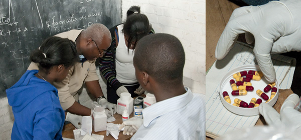 Counting out and dispensing medicine at Nyamucucu mobile clinic school house pharmacy.