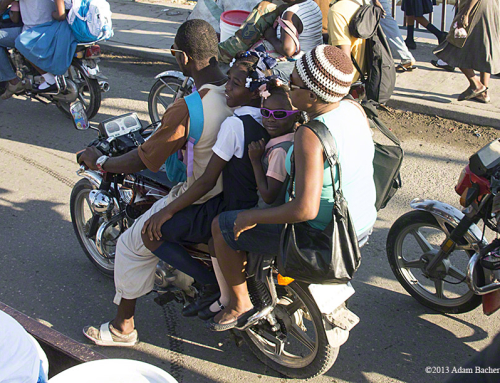 School Girl in Sunglasses on Motorcycle – Cap Haitian, Haiti